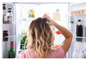 woman looking at food in the refrigerator